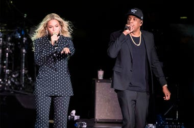In this Nov. 4, 2016 file photo, Beyonce, center, and Jay-Z perform during a Democratic presidential candidate Hillary Clinton campaign rally in Cleveland. Beyonce and Jay-Z, who recently released a collaborative album as The Carters, are nominated for ei