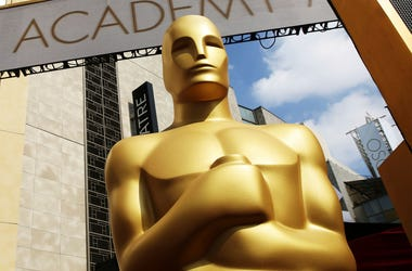 In this Feb. 21, 2015 file photo, an Oscar statue appears outside the Dolby Theatre for the 87th Academy Awards in Los Angeles. The Oscars are adding a new category to honor popular films and promising a brisk 3-hour ceremony on a much earlier air date of