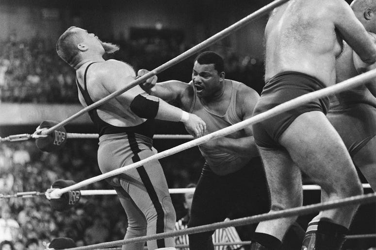 "This April 7, 1986, file photo shows Chicago Bears' William Perry, right, landing a punch on pro wrestler Jim ""The Anvil"" Neidhart during the ""Over-The-Top-Rope"" battle royal at Wrestlemania 2 in Rosemont, Ill. Neidhart, who joined with Bret Hart to form"