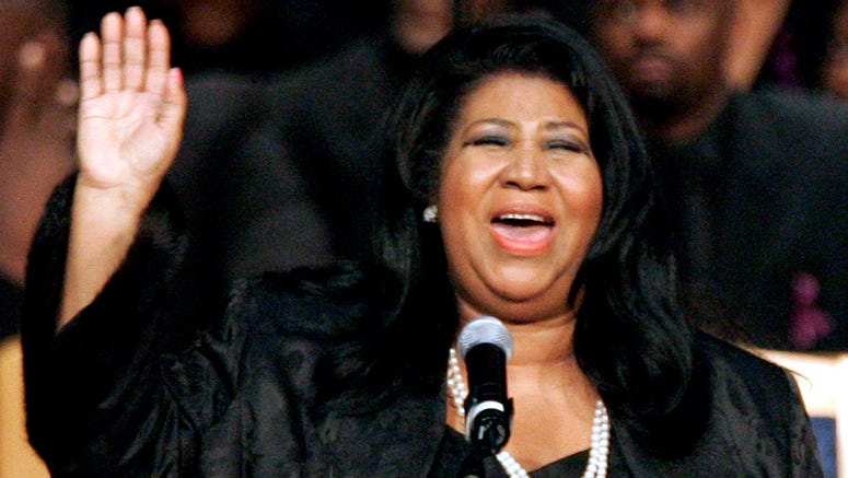 In this Nov. 2, 2005 file photo, Aretha Franklin sings during the funeral for civil rights pioneer Rosa Parks at the Greater Grace Temple in Detroit. Franklin died Aug. 16, 2018 of pancreatic cancer at the age of 76. (AP Photo/Carlos Osorio)