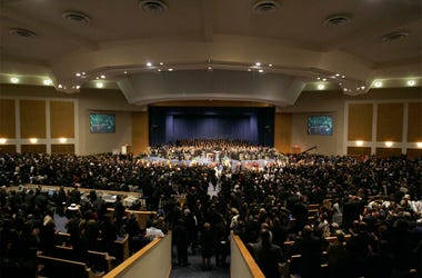 In this Nov. 2, 2005 file photo, people attend the funeral for Rosa Parks at the Greater Grace Temple in Detroit. Aretha Franklin's funeral will be held at Greater Grace Temple in Detroit Friday, Aug. 31, 208. Franklin died Aug. 16, 2018 of pancreatic can