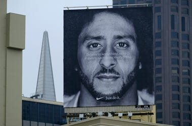 A large billboard stands on top of a Nike store showing former San Francisco 49ers quarterback Colin Kaepernick at Union Square, Wednesday, Sept. 5, 2018, in San Francisco. An endorsement deal between Nike and Colin Kaepernick prompted a flood of debate T