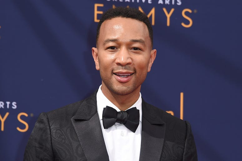 """In this Sept. 9, 2018 file photo, John Legend arrives at the Creative Arts Emmy Awards in Los Angeles. Legend will become a coach on NBC's """"The Voice."""" (Photo by Richard Shotwell/Invision/AP, File)"""