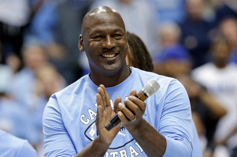 In this March 4, 2017, file photo, former North Carolina basketball player Michael Jordan applauds during a half-time presentation at an NCAA college basketball game between North Carolina and Duke in Chapel Hill, N.C. Jordan, who played high school baske