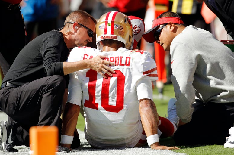 Trainers attend to San Francisco 49ers quarterback Jimmy Garoppolo (10) who was injured after a tackle by Kansas City Chiefs defensive back Steven Nelson during the second half of an NFL football game in Kansas City, Mo., Sunday, Sept. 23, 2018. (AP Photo