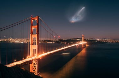 In this photo taken Sunday, Oct. 7, 2018 and provided by Justin Borja, a SpaceX Falcon 9 rocket launch is seen in the distance over the Golden Gate Bridge near Sausalito, Calif. When SpaceX launched a rocket carrying an Argentine Earth-observation satelli