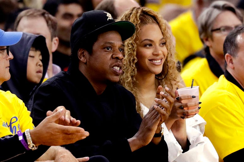 In this April 28, 2018, file photo, Jay-Z and Beyonce watch Game 1 of an NBA basketball second-round playoff series between the Golden State Warriors and the New Orleans Pelicans in Oakland, Calif. Beyonce paid homage to a high-profile music executive bei
