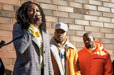 "Chicago mayoral candidate Amara Enyia speaks as Chance the Rapper, center, and Kanye West listen during a ""pull-up"" rally for Enyia Tuesday, Oct. 23, 2018, in Chicago. (Ashlee Rezin/Chicago Sun-Times via AP)"