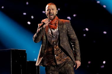 """In this Feb. 4, 2018 file photo, Justin Timberlake performs during halftime of the NFL Super Bowl 52 football game in Minneapolis. Timberlake says he is postponing his Wednesday night concert in New York City because his vocal chords are """"severely bruised"""