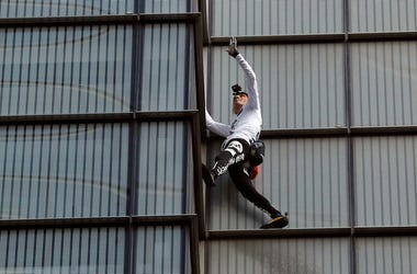 Urban climber dubbed the French Spiderman, Alain Robert scales the outside of Heron Tower building in the City of London, Thursday, Oct. 25, 2018. Heron Tower is over 200 metres high.(AP Photo/Frank Augstein)