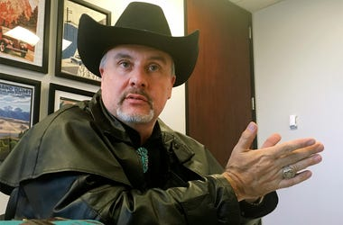 In this April 26, 2018 file photo, Gavin Clarkson of Lac Cruces, N.M., speaks at the Albuquerque bureau of The Associated Press. A District of Columbia clerk refused to accept Clarkson's state driver's license for a marriage license because she and her su