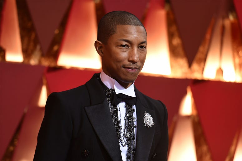 In this Feb. 26, 2017, file photo, Pharrell Williams arrives at the Oscars at the Dolby Theatre in Los Angeles. Cardi B, Pharrell, Kanye West were among the celebrities who fanned out across Miami for a week of glamorous parties toasting the world's best