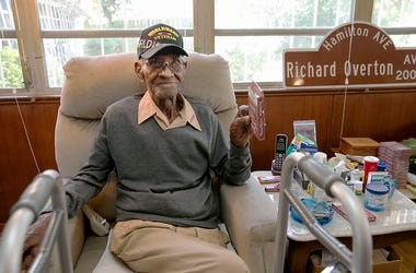 In this May 10, 2018 photo Richard Overton, the oldest living U.S. Veteran at the age of 111, is back in the east Austin home he has owned since 1948 after a renovation provided by Meals on Wheels of Central Texas and the Home Depot Foundation. A family m