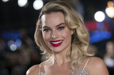 "In this Monday, Dec. 10, 2018, file photo, actress Margot Robbie poses for photographers upon her arrival at the premiere of the film ""Mary Queen of Scots,"" in London. Robbie will bring the Barbie doll to life in a live-action film. Mattel and Warner Bros"