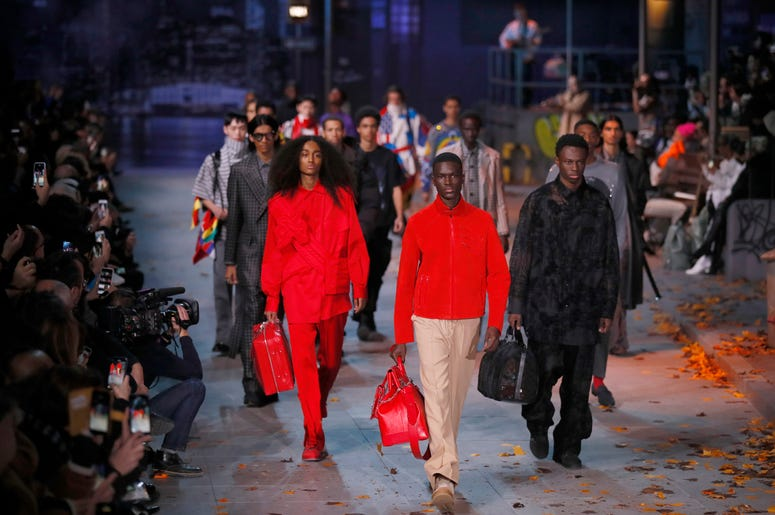 Models wear creations for the Vuitton men's Fall/Winter 2019/20 fashion collection presented in Paris, Thursday Jan.17, 2019. (AP Photo/Francois Mori)