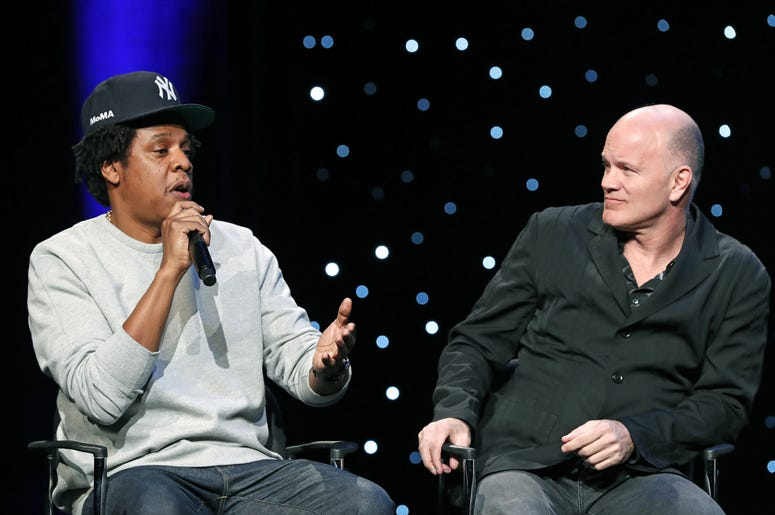"""Rapper and business mogul Shawn """"Jay-Z"""" Carter, left, speaks as Michael Novogratz, founder and CEO Galaxy Digital, listens during the launch of a partnership among entertainment moguls, recording artists, business and sports leaders who hope to transform"""