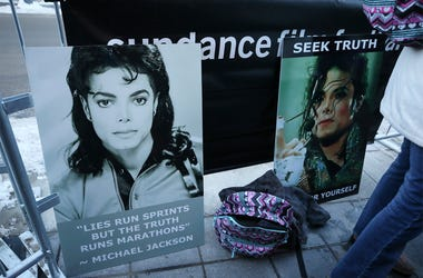 """Signs in support of Michael Jackson are seen outside of the premiere of the """"Leaving Neverland"""" Michael Jackson documentary film at the Egyptian Theatre on Main Street during the 2019 Sundance Film Festival, Friday, Jan. 25, 2019, in Park City, Utah. (Pho"""