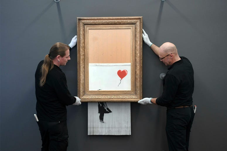 """The shredded Banksy painting """"Love is in the Bin 'is being exhibited at the Museum Frieder Burda in Baden-Baden Monday Feb. 4, 2019, where the work will be shown from Feb. 5 to March 3, 2019. It was originally titled 'Girl with Balloon' and since it destr"""