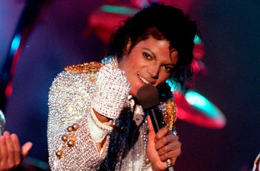In this Dec. 3, 1984 photo, Michael Jackson performs with his brothers at Dodger Stadium in Los Angeles, as part of their Victory Tour concert. The Michael Jackson estate has sent a letter to the U.K.'s Channel 4 warning that a documentary on men who accu