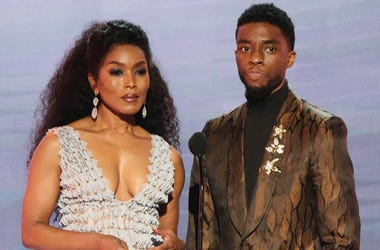 """In this Jan. 27, 2019, file photo, Angela Bassett, left, and Chadwick Boseman, nominated for outstanding performance by a cast in a motion picture, introduce a clip from their film """"Black Panther"""" at the 25th annual Screen Actors Guild Awards at the Shrin"""