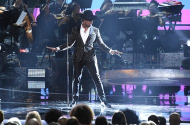 Ne-Yo performs during Motown 60: A GRAMMY Celebration at the Microsoft Theater on Tuesday, Feb. 12, 2019, in Los Angeles. (Photo by Richard Shotwell/Invision/AP)