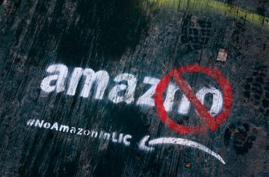 In this Nov. 16, 2018, file photo graffiti has been painted on a sidewalk by someone opposed to the location of an Amazon headquarters in the Long Island City neighborhood in the Queens borough of New York. Amazon said Thursday, Feb. 14, 2019, that it wil