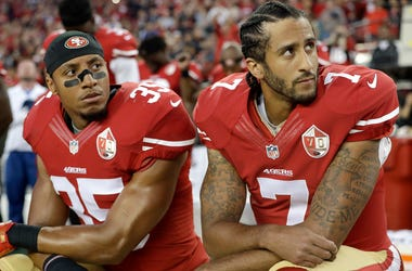 In this Sept. 12, 2016, file photo, San Francisco 49ers safety Eric Reid (35) and quarterback Colin Kaepernick (7) kneel during the national anthem before an NFL football game against the Los Angeles Rams, in Santa Clara, Calif. Colin Kaepernick and Eric