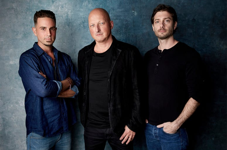 """In this Jan. 24, 2019, file photo, Wade Robson, from left, director Dan Reed and James Safechuck pose for a portrait to promote the film """"Leaving Neverland"""" during the Sundance Film Festival in Park City, Utah. The documentary premiered at the Sundance Fi"""