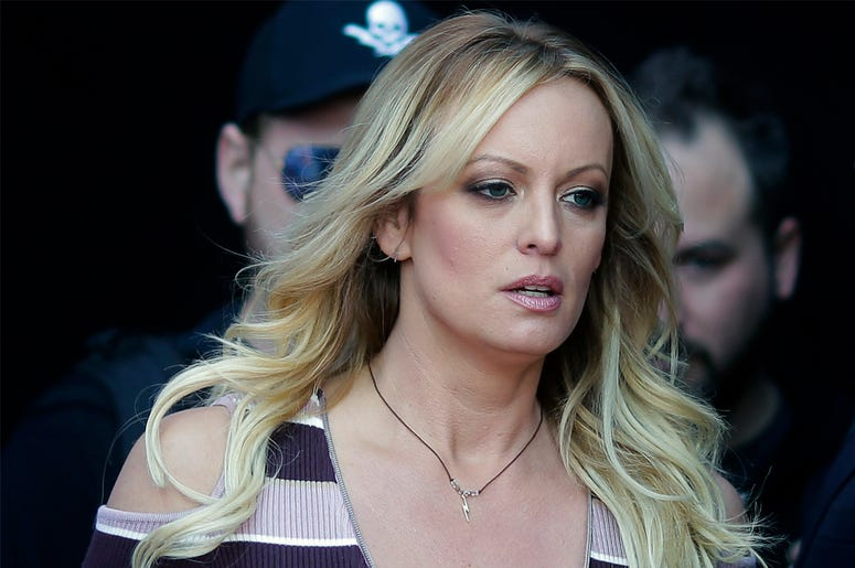 "In this Oct. 11, 2018, file photo, adult film actress Stormy Daniels arrives at the adult entertainment fair ""Venus"" in Berlin. (AP Photo/Markus Schreiber, File)"