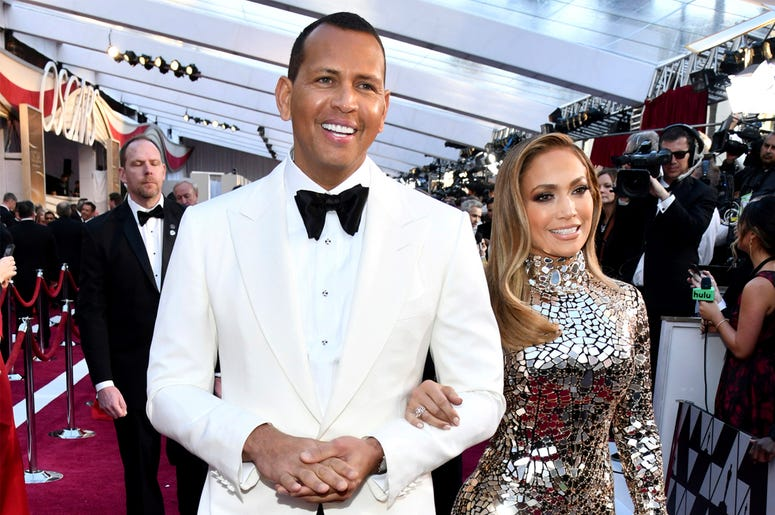In this Sunday, Feb. 24, 2019, file photo, Alex Rodriguez, left, and Jennifer Lopez arrive at the Oscars at the Dolby Theatre in Los Angeles. (Photo by Charles Sykes/Invision/AP, File)