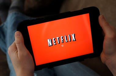 In this Friday, Jan. 17, 2014, file photo, a person displays Netflix on a tablet in North Andover, Mass. (AP Photo/Elise Amendola, File)