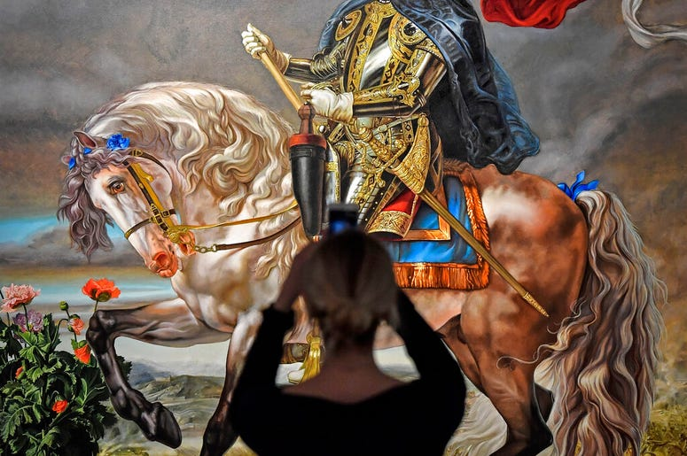 A visitor takes a smartphone picture of the painting 'Equestrian portrait of King Philipp II (Michael Jackson)' from US artist Kehinde Wiley at a preview of the exhibition 'Michael Jackson: On The Wall' at the Bundeskunsthalle museum in Bonn, Germany, Thu