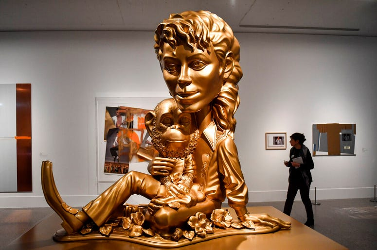 The sculpture 'Michael Jackson and Bubbles' from US artist Paul McCarthy' is presented at a preview of the exhibition 'Michael Jackson: On The Wall' at the Bundeskunsthalle museum in Bonn, Germany, Thursday, March 21, 2019. The exhibition around the contr