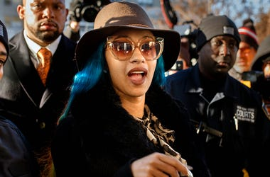 This Dec. 7, 2018 file photo shows Rapper Cardi B, center, arriving at Queens County Criminal Court in New York on charges related to a brawl at a New York strip club. (AP Photo/Andres Kudacki, File)