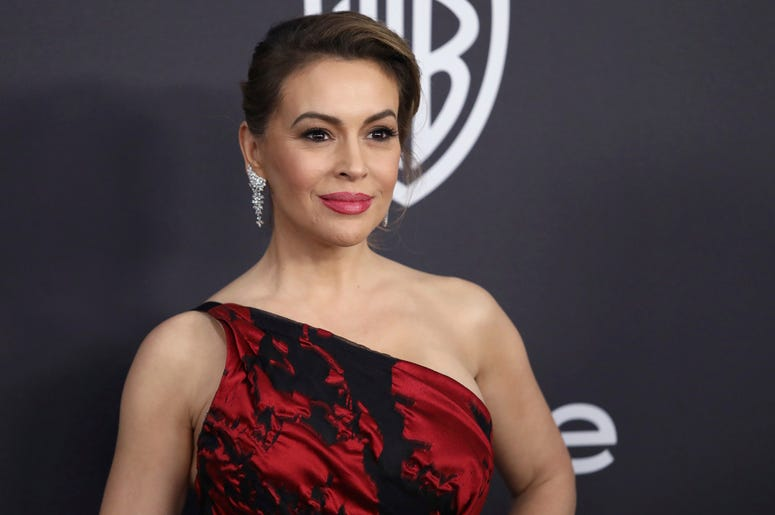In this Jan. 6, 2019 file photo, Alyssa Milano arrives at the InStyle and Warner Bros. Golden Globes afterparty at the Beverly Hilton Hotel in Beverly Hills, Calif. (Photo by Matt Sayles/Invision/AP, File)