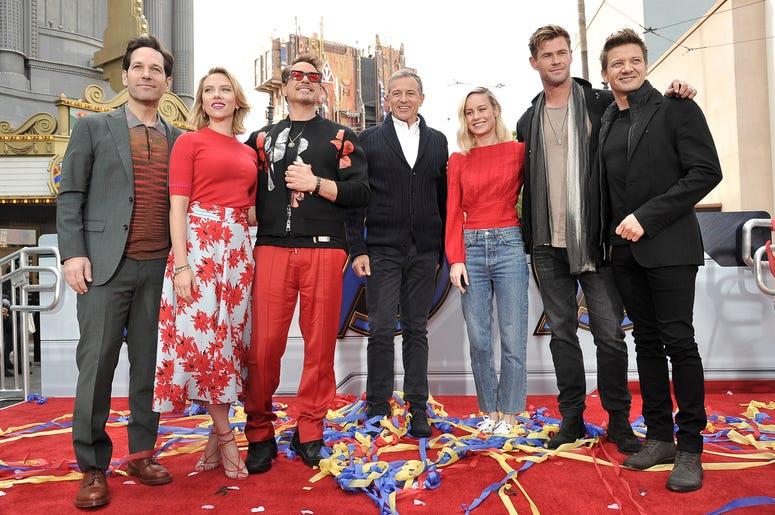 """Avengers: Endgame"" cast members, Paul Rudd, from left, Scarlett Johansson, Robert Downey Jr., Robert Iger, Brie Larson, Chris Hemsworth and Jeremy Renner appear at an event announcing the Universe Unites Charity at Disney California Adventure Park on Fri"