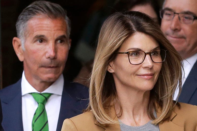 In this April 3, 2019 file photo, actress Lori Loughlin, front, and husband, clothing designer Mossimo Giannulli, left, depart federal court in Boston after facing charges in a nationwide college admissions bribery scandal. (AP Photo/Steven Senne, File)