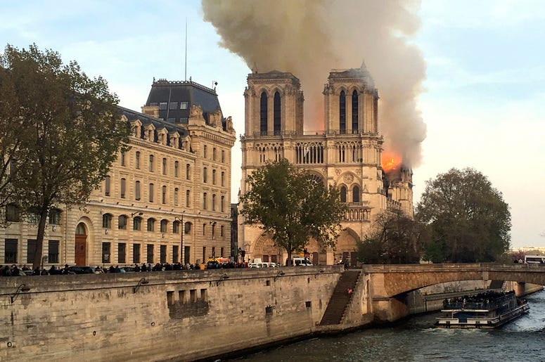 Flames rise from Notre Dame cathedral as it burns in Paris, Monday, April 15, 2019.  (AP Photo/Lori Hinant)