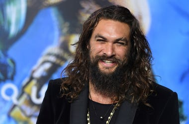 """In this Dec. 12, 2018 file photo, Jason Momoa arrives at the premiere of """"Aquaman"""" at TCL Chinese Theatre in Los Angeles.  (Photo by Jordan Strauss/Invision/AP, File)"""