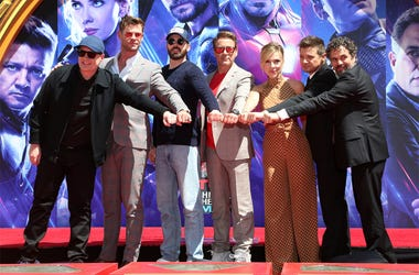 "Marvel Studios President Kevin Feige, from left, poses with members of the cast of ""Avengers: End Game,"" Chris Hemsworth, Chris Evans, Robert Downey Jr., Scarlett Johansson, Jeremy Renner and Mark Ruffalo at a hand and footprint ceremony at the TCL Chines"