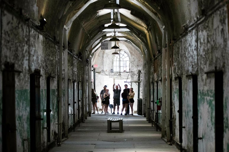Tourist visit a cellblock of the Eastern State Penitentiary, Thursday, May 2, 2019, which is now a museum in Philadelphia. (AP Photo/Matt Rourke)