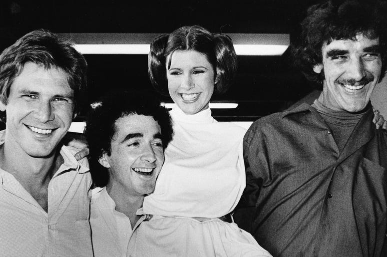 "In this Oct. 5, 1978 file photo, actors featured in the ""Star Wars"" movie, from left, Harrison Ford who played Han Solo, Anthony Daniels who played the robot C3P0, Carrie Fisher who played the princess, and Peter Mayhew who played the Wookie, Chewbacca, a"