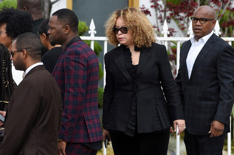 Costume designer Ruth Carter, second from right, arrives at a memorial service for the late film director John Singleton at Angelus Funeral Home, Monday, May 6, 2019, in Los Angeles. Singleton died on April 29 following a stroke. (AP Photo/Chris Pizzello)
