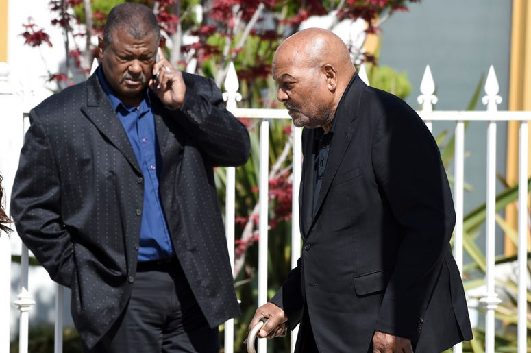 NFL football legend and actor Jim Brown, right, arrives at a memorial service for the late film director John Singleton at Angelus Funeral Home, Monday, May 6, 2019, in Los Angeles. Singleton died on April 29 following a stroke. (AP Photo/Chris Pizzello)