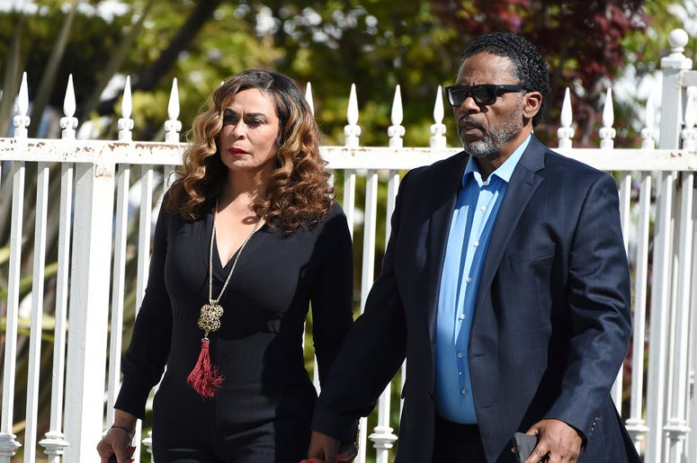 Tina Knowles, left, and husband Richard Lawson arrive at a memorial service for the late film director John Singleton at Angelus Funeral Home, Monday, May 6, 2019, in Los Angeles. Singleton died on April 29 following a stroke. (AP Photo/Chris Pizzello)