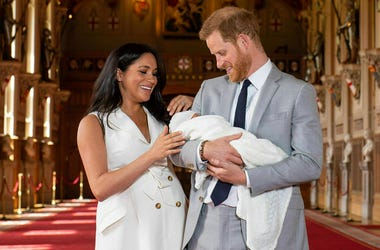 Britain's Prince Harry and Meghan, Duchess of Sussex, during a photocall with their newborn son, in St George's Hall at Windsor Castle, Windsor, south England, Wednesday May 8, 2019. (Dominic Lipinski/Pool via AP)