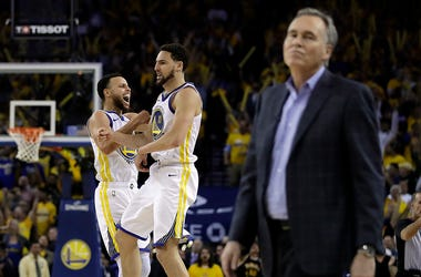 Golden State Warriors' Stephen Curry, left, and Klay Thompson celebrate as Houston Rockets coach Mike D'Antoni walks onto the court during the second half of Game 5 of a second-round NBA basketball playoff series Wednesday, May 8, 2019, in Oakland, Calif.