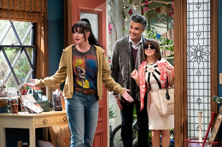 """This image released by CBS shows, from left, Pauley Perrette, Jaime Camil and Natasha Leggero in a scene from the sitcom """"Broke."""" (Sonja Flemming/CBS via AP)"""