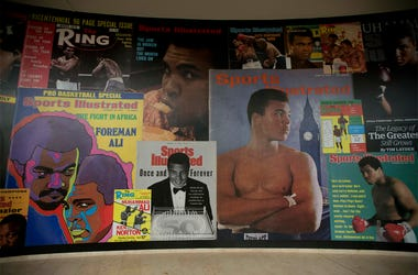 """In this June 4, 2016, file photo large posters of mostly Sports Illustrated magazine covers are displayed at the """"I Am The Greatest, Muhammad Ali"""" exhibition at the O2 arena, which hosts high profile boxing fights in London. (AP Photo/Matt Dunham, File)"""