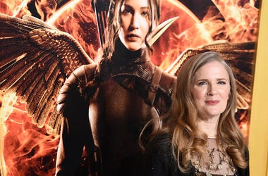 "In a Monday, Nov. 17, 2014 file photo, Suzanne Collins arrives at the Los Angeles premiere of ""The Hunger Games: Mockingjay - Part 1"" at the Nokia Theatre L.A. Live. (Photo by Jordan Strauss/Invision/AP, File)"